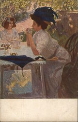 Woman Leaning with Elbows on Table Holding Tea Cup