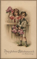 Boy and Girl Standing Near Fence Holding Lilacs