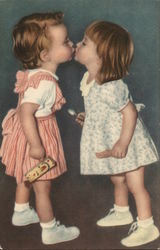 Two Little Girls Kissing with Eyes Closed
