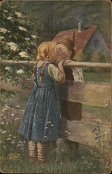 Boy and Girl Kissing Over Fence Top