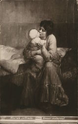 Woman Holding and Kissing Baby