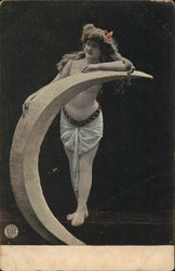 Scantily Clad Woman Leaning on Crescent Moon