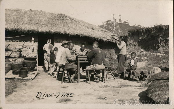 Dine-Time Outside Thatched Cottage China