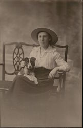 Woman with Glasses, Dog and Flat Brimmed Large Hat
