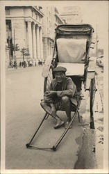 A Man and Poses With His Rickshaw