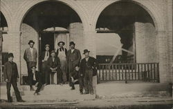 Men in Front of Building