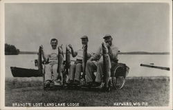Fishermen in Wheelcharis with Catch at Brandt's Lost Land Lake Lodge