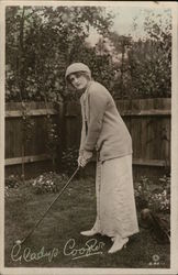 Gladys Cooper playing Golf