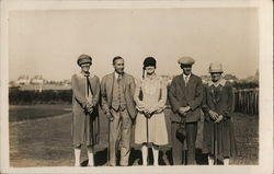 Five Men and Women on Golf Course
