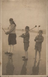 Three Children With Golf Clubs