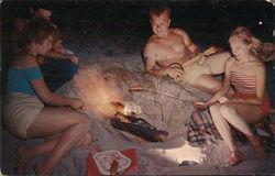 Two Young Couples Roasting Hot Dogs on the Beach