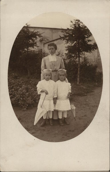 A Woman With Two Small Girls Children
