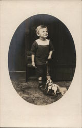 Snapshot of Boy With Pull Toy