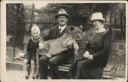 Family Holding Lion at Zoo