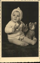 Baby with Rattle and Stuffed Cat