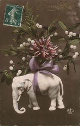 Bouquet Tied with Purple Bow Atop Carved Elephant Postcard