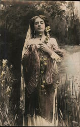 Woman with Bare Shoulders by Pond with Flowers