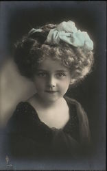 Photo of Elegantly Dressed Young Girl with Bow