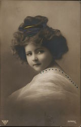 Young Girl with Fancy Hairstyle and Gauzy Dress