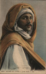 Man Wearing Turban Beneath Brown Hood