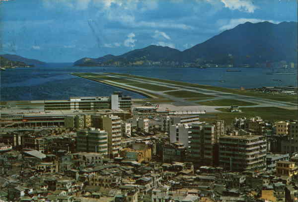 Kai Tak Airport with its modern runway that points to the Lyemoon Pass Hong Kong