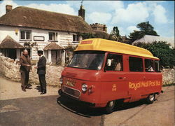 The Honiton Royal Mail Post Bus shown here at Dunkeswell Post Office. Postcard