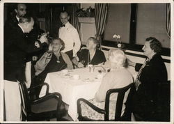 Elderly Dining on a Ship with Captain Toasting