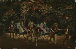 Two hand-pulled rickshaws carrying four upper class ladies.