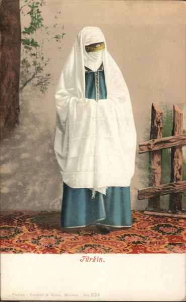 Woman Dressed in Blue and White Robes with Face Obscured