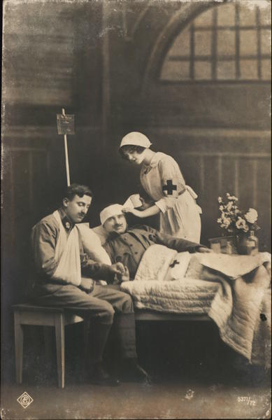 Nurse Assisting Two Injured Soldiers Military