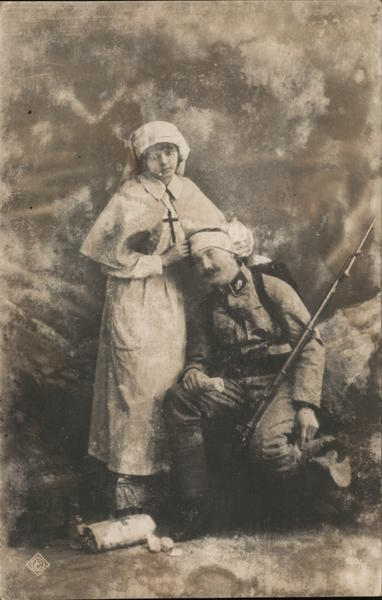 Nurse with wounded soldier Military