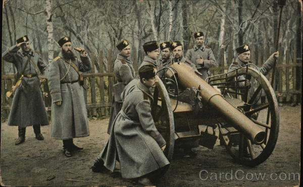 Soldiers Wearing Long Coats at Cannon on Wheels Military