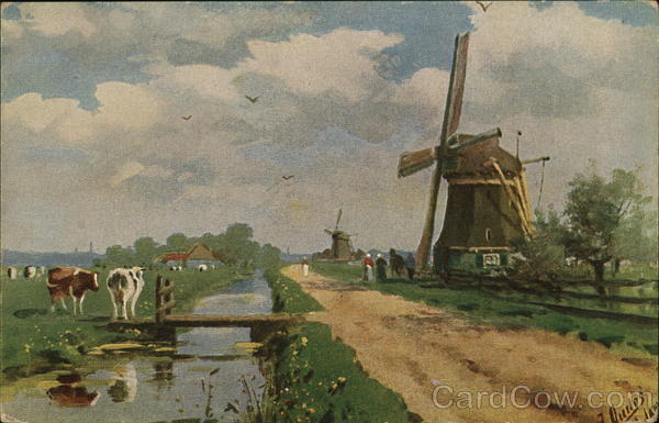 A windmill by a creek with cows Windmills