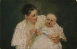 Woman Holding Baby in White Dress