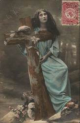 Woman with Long, Dark Hair Holding Large Cross
