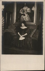 Woman Holding Fan Seated in Front of Portrait