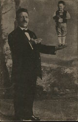 Man with Arm Extended, Holding Tiny Man