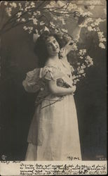Woman Posed Holding Tree Blossoms Postcard