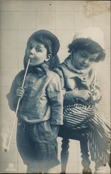 Two Young Children with Long-Stemmed Pipes