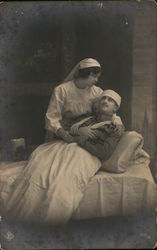 Uniformed Nurse Cradling Injured Soldier