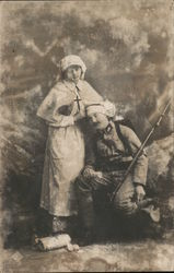 Nurse with wounded soldier
