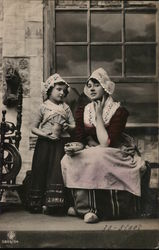 Girl Holding Teapot Standing Near Woman with Tea Cup