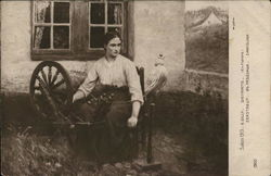 Young Woman Seated at Spinning Wheel Outdoors