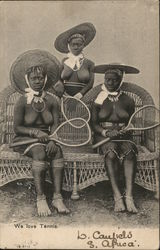 Three Topless Native Women Holding Tennis Rackets