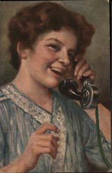 Woman speaking on an early telephone