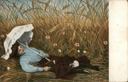 Woman Laying Amid Tall Grass Reading Book, Holding Parasol