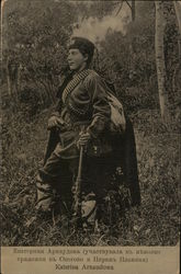 Katerina Arnaudowa - Soldier Holding Rife, Wearing Bullet Belts, Outdoors Near Trees