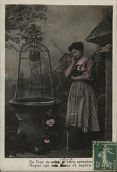 French Woman with Pensive Expression Standing Near Well