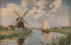 Boat Sails Along Canal Beside Windmill