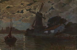 Windmill and boat at night